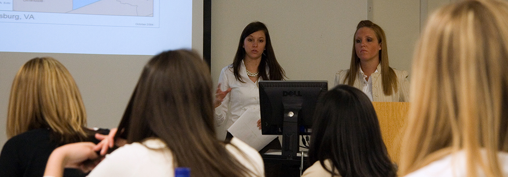 Health Administration students giving a presentation